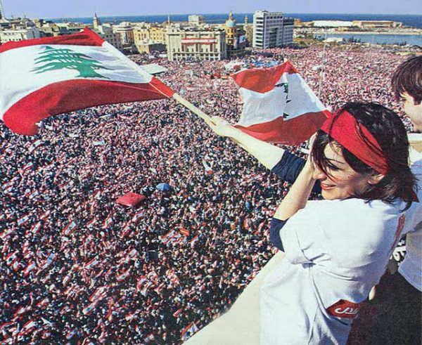 On March 14, 2005, a month after Hariri's assassination , over a million Lebanese headed to downtown Beirut to demand the withdrawal of Syrian troops from Lebanon after a nearly 29-year of military presence. The mass rally was later dubbed the Cedar Revolution or Independence Uprising.