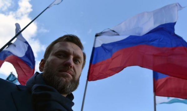 Russian opposition leader and anti-corruption blogger Alexei Navalny attends a memorial march marking the one-year anniversary of the assassination of Russian politician Boris Nemtsov in central Moscow, on February 27, 2016. Nemtsov, a former deputy prime minister in the government of Boris Yeltsin, was gunned down shortly before midnight on February 27, 2015, while walking across a bridge a short distance from the Kremlin with his Ukrainian model girlfriend. AFP PHOTO / KIRILL KUDRYAVTSEV / AFP / KIRILL KUDRYAVTSEV (Photo credit should read KIRILL KUDRYAVTSEV/AFP/Getty Images)
