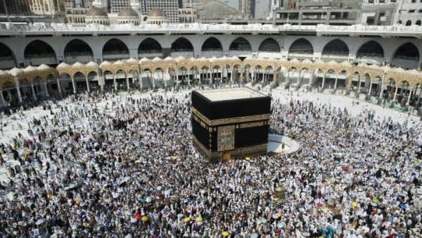 Muslim pilgrims sit around the Kaaba, the cubic building at the Grand Mosque, ahead of the annual Hajj