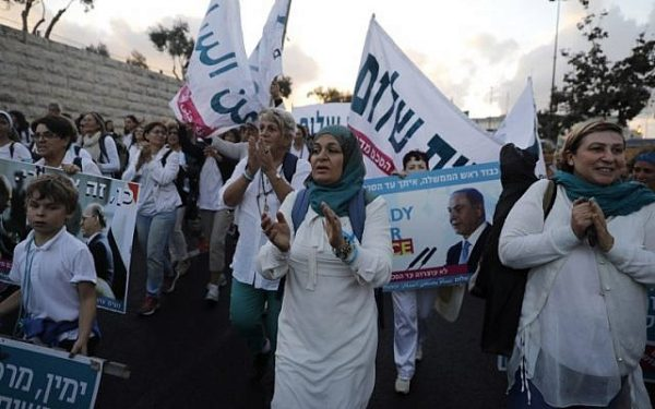 Israeli and Palestinian activists of the Women Wage Peace movement march in Jerusalem on October 8, 2017, as they end a two-week peace march.
