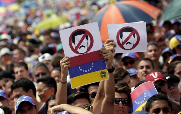 Opposition supporters take part in a rally against President Nicolas Maduro's government in Caracas, Venezuela,