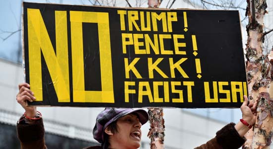 People demonstrate against U.S. President Donald Trump and Vice President Mike Pence