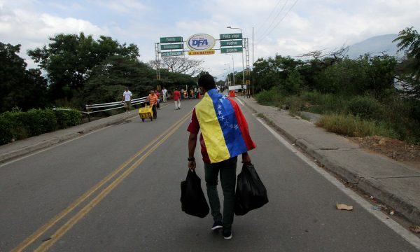 A man crosses the Francisco de Paula Santander international bridge, linking Urena, Venezuela, and Cucuta, Colombia. Photograph: George Castellanos/AFP/Getty Images