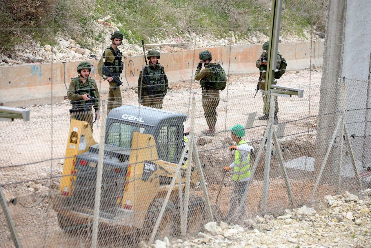 Israeli workers are seen building a  border   near the village of Naqoura, Lebanon February 8, 2018. REUTERS/Ali Hashisho