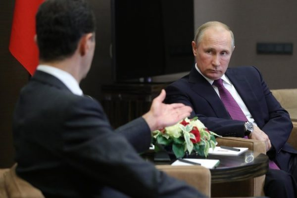 President Bashar al-Assad of Syria, left, and President Vladimir V. Putin of Russia in Aleppo, Syria.  CreditHassan Ammar/Associated Press