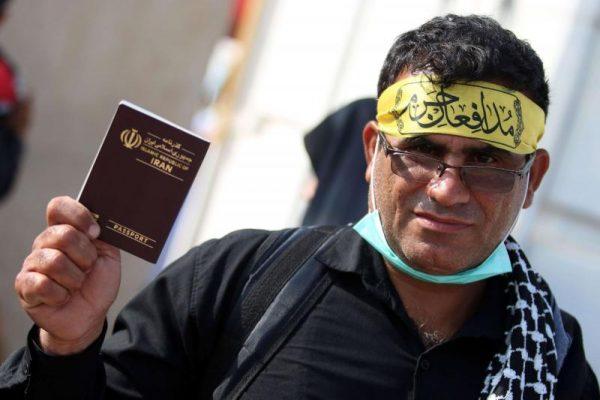 An Iranian shiite militia fighter is shown entering Iraqi border