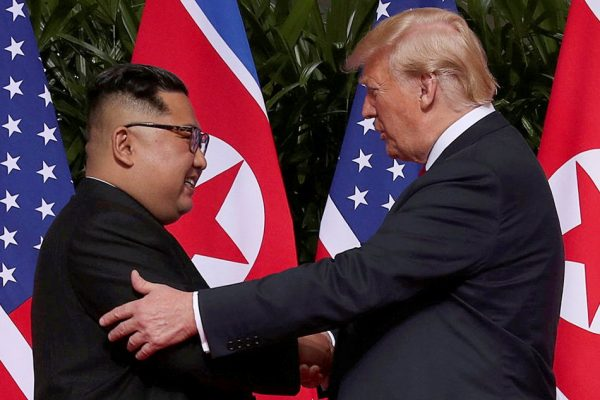 US President Donald Trump shakes hands with North Korean leader Kim Jong Un at the Capella Hotel on Sentosa island in Singapore Tuesday June 12, 2018. Jonathan Ernst, Reuters