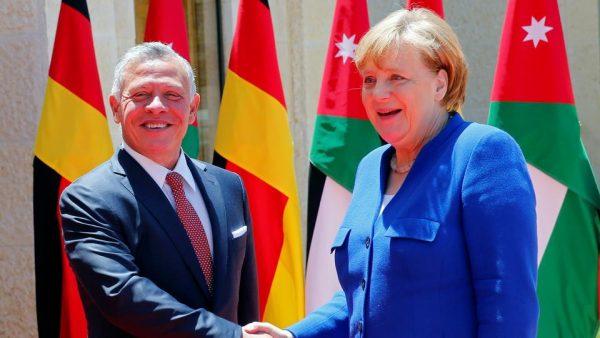 German Chancellor Angela Merkel shakes hands with Jordan's King Abdullah II at the Royal Palace in Amman on June 21, 2018. (Reuters)