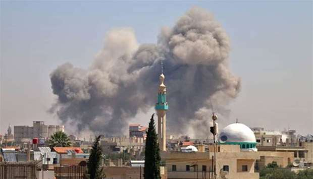 Smoke rises in the rebel-held town of Nawa, about 30 kilometres north of Deraa in southern Syria on Wednesday, during airstrikes by Syrian regime forces.