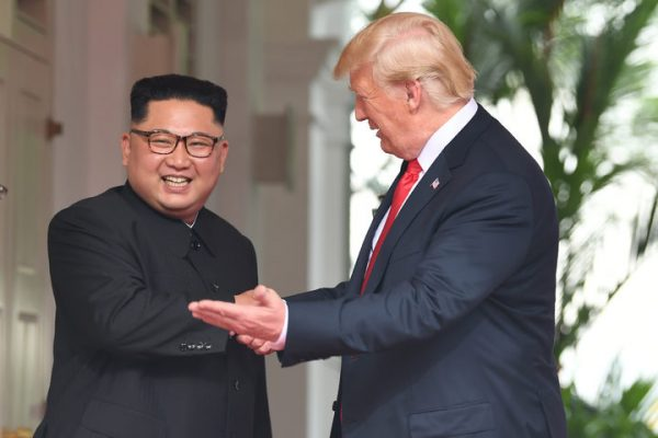 US President Donald Trump (R) gestures as he meets with North Korea's leader Kim Jong Un (L) at the start of their historic US-North Korea summit, at the Capella Hotel on Sentosa island in Singapore on June 12, 2018. Photo: AFP
