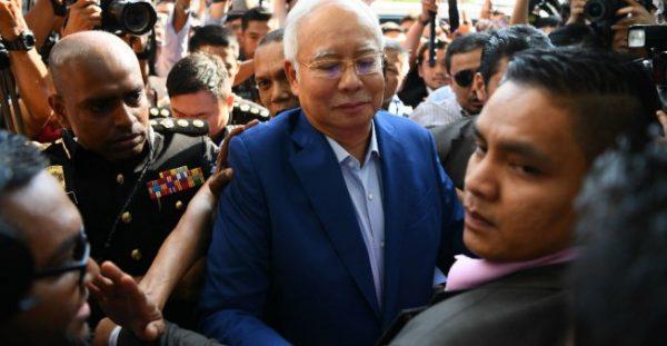 Manan Vatsyayana, AFP | File photo taken on May 22, 2018 of Malaysian former PM Najib Razak arriving at the Malaysian Anti-Corruption Commission (MACC) office in Putrajaya.