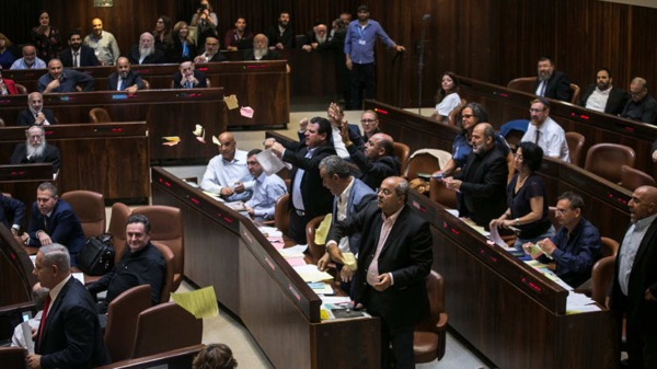 Arab lawmakers tear up copies of the nation-state law in the Knesset, July 19, 2018. Olivier Fitoussi