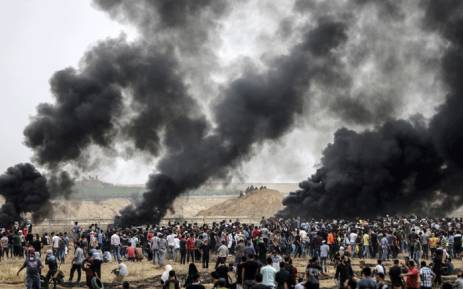 A picture taken from the border with Israel in the northern Gaza strip east of Gaza City shows a general view of a clashes between Palestinians and Israeli forces. Picture: AFP