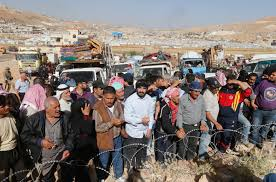 Syrian refugees prepare to return to Syria from the Lebanese border town of Arsal, Lebanon