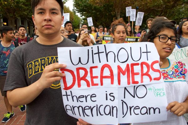 FILE PHOTO: Activists and DACA recipients march up Broadway during the start of their 'Walk to Stay Home,' a five-day 250-mile walk from New York to Washington D.C., to demand that Congress pass a Clean Dream Act, in Manhattan, New York, U.S., February 15, 2018. REUTERS/Shannon Stapleton/File Photo