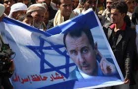 """A banner that reads """" Bashar , the protector of Israel"""