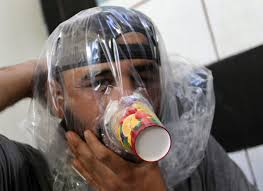 A boy tries on an improvised gas mask in Idlib, Syria September 3, 2018. REUTERS/Khalil Ashawi