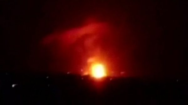 There are conflicting reports about the cause of a series of blasts at a military airport near Damascus , Syria on Sunday . The Syrian regime has denied reports that they were caused by Israeli air strikes, state media say.