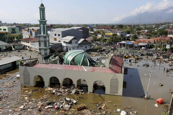 People survey the mosque damaged in a massive earthquake and a tsunami in Palu, Central Sulawesi in Indonesia. (AP)