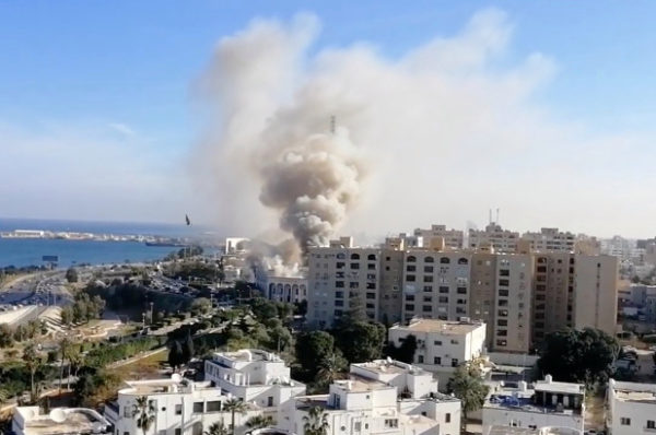 Smoke rises from the Libyan foreign ministry building in Tripoli, Libya.