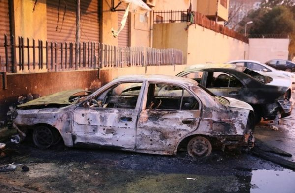 Burned cars are seen at the site of the headquarters of Libya's Foreign Ministry after suicide attackers hit in Tripoli, Libya December 25, 2018. REUTERS/Hani Amara