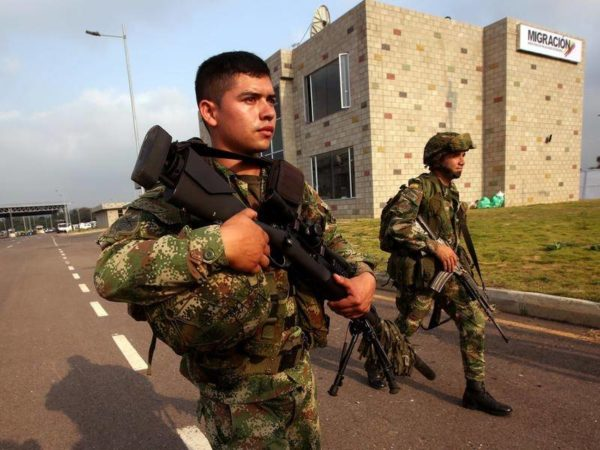 Venezuelan troops have killed a woman near the Brazilian border as tensions grow over access to aid.