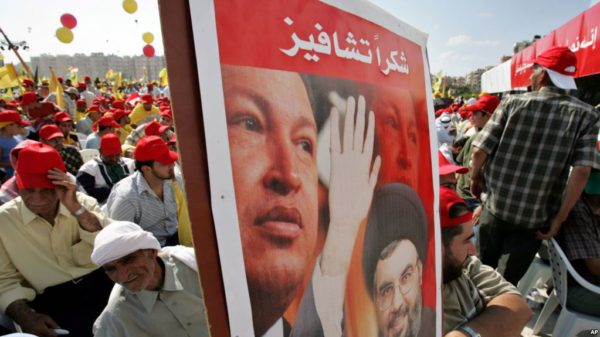 Hezbollah leader Hassan Nasrallah and Venezuela's President Hugo Chavez, top, during a Hezbollah victory rally in Beirut 0n Friday, Sept. 22, 2006.