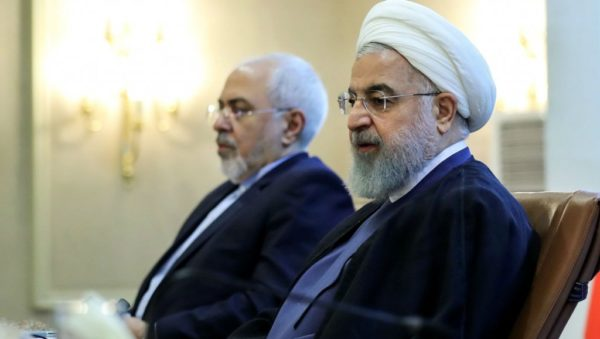 AFP | President Hassan Rouhani (right) attends a meeting with Foreign Minister Mohammad Javad Zarif in Tehran in July 2018.