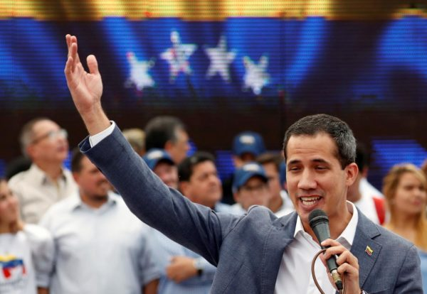 Venezuelan opposition leader Juan Guaido, who many nations have recognised as the country's rightful interim ruler, speaks during a swearing-in ceremony for supporters in Caracas, Venezuela April 27, 2019. REUTERS/Carlos Garcia Rawlins
