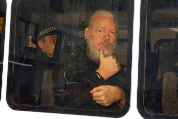 WikiLeaks founder Julian Assange is seen in a police van after was arrested by British police outside the Ecuadorian embassy in London, Britain April 11, 2019. Henry Nicholls | Reuters