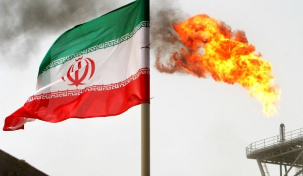 An Iranian flag flies at the Sorough oil field in 2005. (Raheb Homavandi/Reuters)