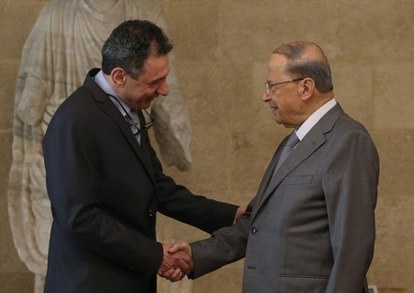 Nizar Zakka is shaown shaking hands with president Michael Aoun at Lebanon's presidential palace. Zakka , a Lebanese technology expert and advocate for Internet freedom, was arrested in Tehran in September 2015 after being invited by the Iranian government to attend and speak at a conference in Tehran .
