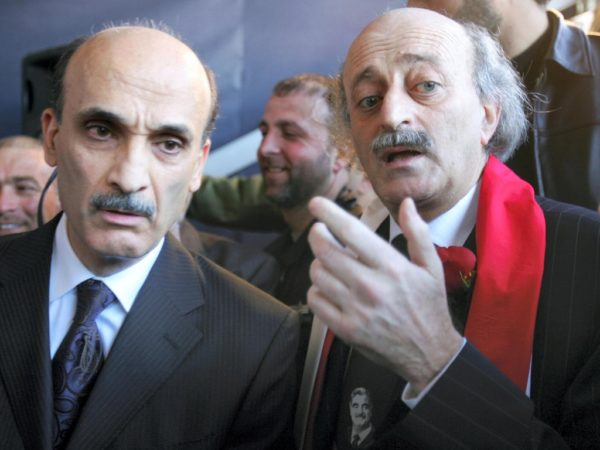 Walid Jumblatt and Samir Geagea at a mass gathering to mark the first anniversary of the assassination of Lebanese statesman Rafic Harir in central Beirut 14 February 2006. The two figures were then members an alliance that helped drive out Syrian troops from Lebanon through non-violent resistance. Hezbollah has refused to hand four of its operatives suspected for involvement in the assassination to a United Nations tribunal in The Hague.AFP