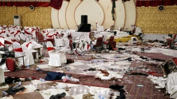 A suicide bomber killed at least 63 people and wounded 182 in an explosion at a packed wedding hall in Kabul, Afghanistan