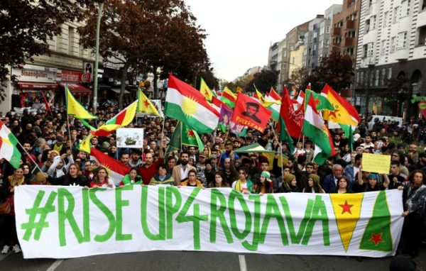 Kurdish protesters in Berlin, Germany, carry a banner during a demonstration on Oct. 12 against Turkey's military action in northeastern Syria.