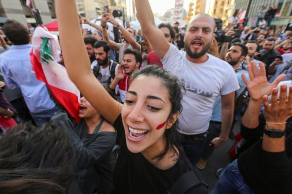 Protesters celebrating the resignation of PM Hariri