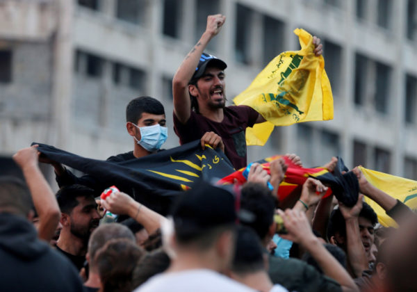 Anti-government protesters, left were attacked by Hezbollah supporters, right, during a protest near the government palace, in downtown Beirut, Lebanon, Tuesday   Oct. 29, 2019.   (AP Photo/Hussein Malla)