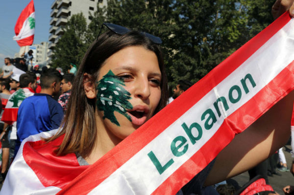 Lebanese women take part in a demonstration in A demonstrator takes part in an anti-government protest in the southern city of Nabatiyeh, Lebanon October 21, 2019. (Reuters)