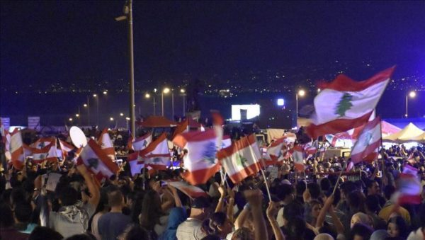 A number of protesters were injured on Friday in Riad al-Solh square in Beirut after Hezbollah supporters stormed the square and attacked them with sticks, a Lebanese TV channel reported.