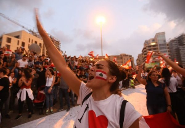Lebanese demonstrators chant slogans as they take part in a rally in the capital Beirut's downtown district on October 20 ANWAR AMRO/AFP/GETTY