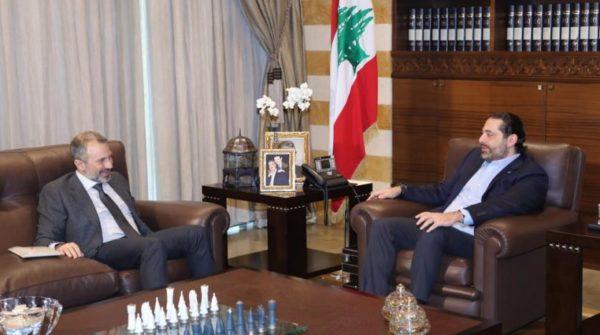Lebanese caretaker PM Saad Hariri (R) receives caretaker Foreign Minister Gebran Bassil at the Center House in Beirut. (NNA file photo)